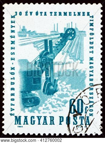 Hungary - Circa 1964: A Stamp Printed In Hungary Shows Excavating Bauxite, 30th Year Of Bauxite Mini
