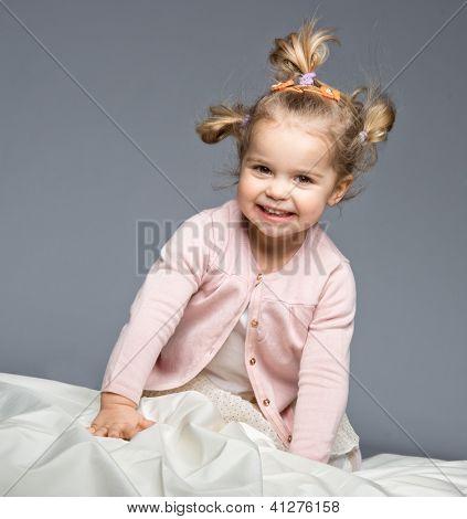 Little girl having fun on bed