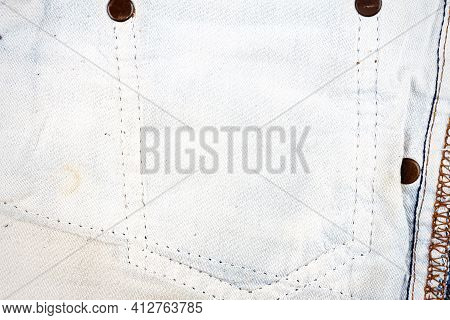 Closeup Of Jeans Fabric With Side Pocket Background. Jeans Detail. Blue Jeans Texture Background. Wr