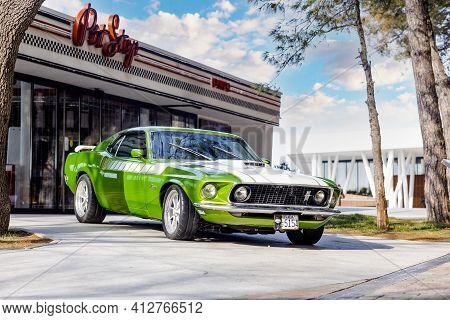 04.02.2021 California, Usa. Retro Muscle Car Chevrolet Camaro Light Green Color Near The Building. S