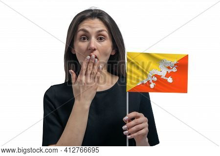 Happy Young White Woman Holding Flag Of Butane And Covers Her Mouth With Her Hand Isolated On A Whit