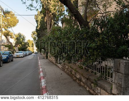 Jerusalem, Israel, February 27, 2021 : Evening View Of The Quiet, Green Hovevei Tsiyon Street In The