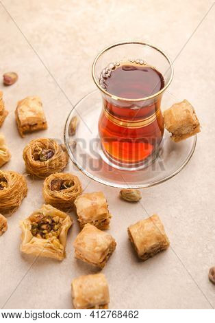 A traditional Arabic cup of Black tea and Baklawa. A popular Middle Eastern hot beverage served with Turkish sweet.