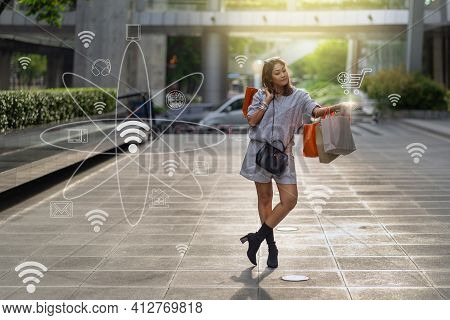 Portrait Of Happy Asian Woman Walking And Holding The Shopping Bag Which Online Shopping Via Omni Ch