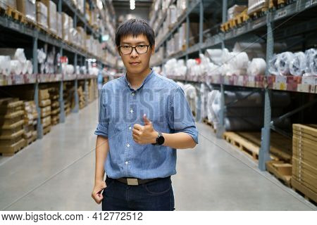 Portrait Asian Men, Staff, Product Counting Warehouse Control Manager Standing, Counting And Inspect
