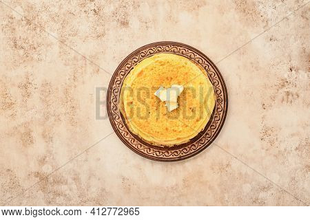 Crepes Or Thin Pancakes Stack With Butter And Red Caviar On Beautiful Ceramic Plate On An Old Brown