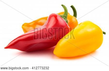 Red Orange And Yellow Peppers Are Isolated On A White Background. Three Colorful Peppers.