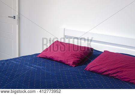 Scandinavian Style. White Bedroom With Bright Scandinavian Bedding