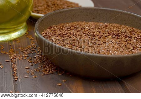 Flax Seeds On A Wooden Background. Flax Seed Oil Healthy Food Concept