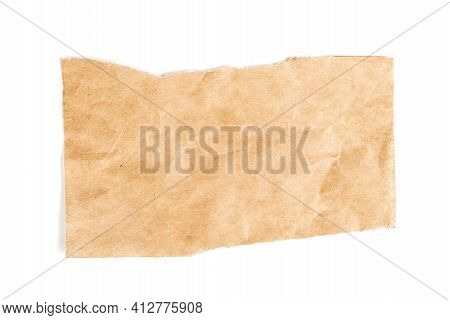 Close Up Of A Ripped Piece Of Brown Paper On White Background