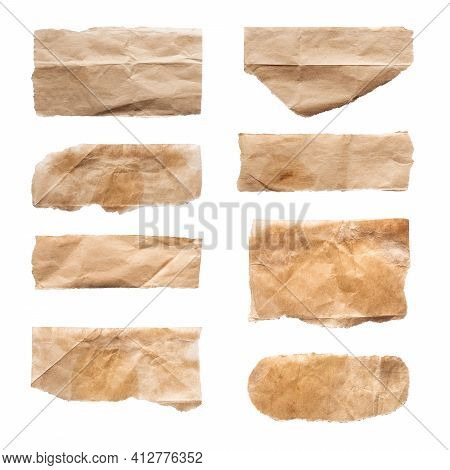 Close Up Of A Ripped Piece Set Of Brown Paper On White Background