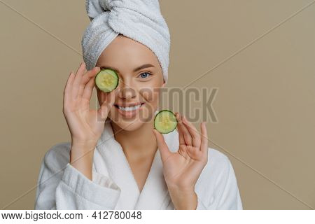 Skin Care Natural Beauty And Cosmetology Concept. Positive Refreshed Beautiful Woman Holds Slices Of