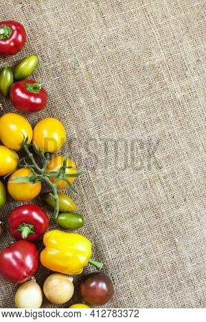 Assortment Of Colorful Fresh Vegetables On Sackcloth Background. Flat Lay, Top View. Copy Space.