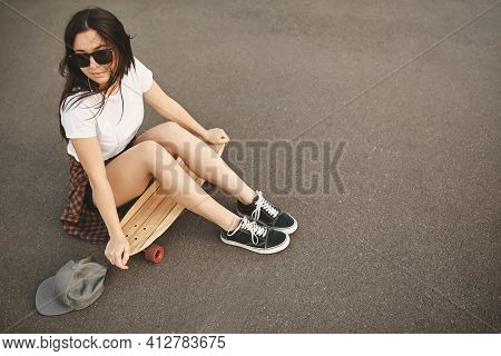 Upper View Hipster Teenage Girl In Sunglasses, Snapback, Turn Aside Pensive, Sit On Concrete Floor W