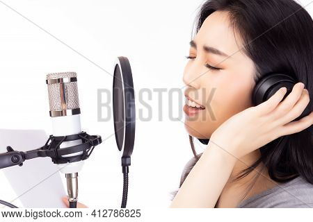 Portrait Young Asian Woman Recording Song In A Recording Studio. Singer Female Performing And Singin