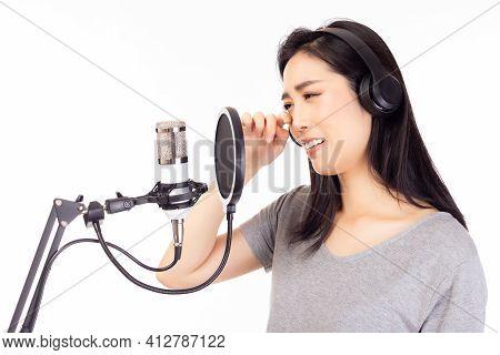 Singer Woman Singing Sad Song Or Broken Heart Song In Recording Studio, Using Microphone, Pop Filter