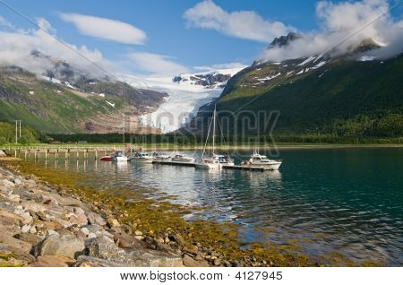 Boats on Norwegian fjord with glacier in background poster
