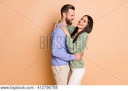 Photo Of Young Cheerful Positive Smiling Good Mood Couple Laugh Hug Each Other Isolated On Beige Col