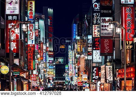 Tokyo, Japan - November 18, 2018: Advertisement billboards and signs on Kabukicho Ichiban-gai street in Shinjuku's nightlife district. The area is an entertainment and red-light district.