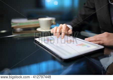 Close Up Of A Tele Worker Checking Online Graphs On A Tablet Late Hours At Homeoffice