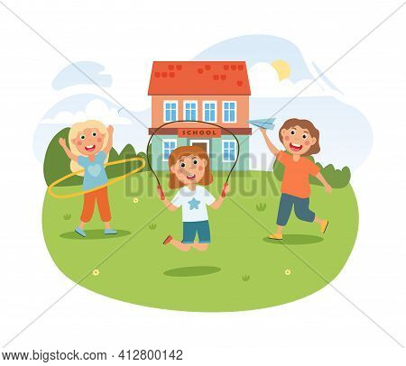 Cute Little Children Are Playing Together With School Building On The Background. Three Little Girls