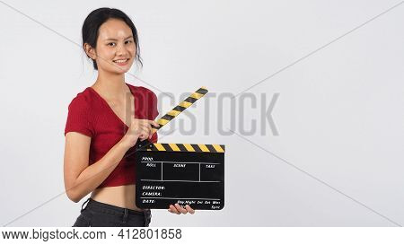 Girl Or Woman Hand's Holding Black Clapper Board Or Movie Slate Or Slate ,use In Video Production ,f