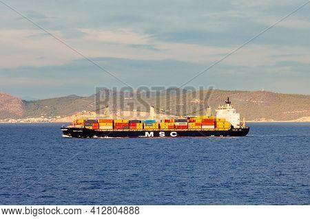 Syros Island, Greece - October 21, 2016: Container Ship Or Cargo Ship In The Aegian Sea In Greece.