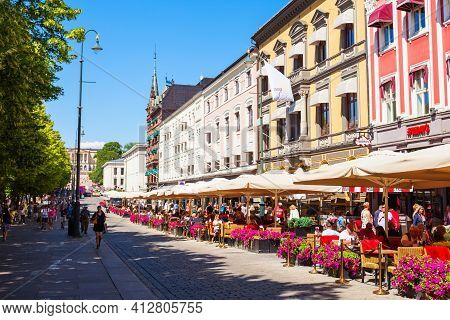 Oslo, Norway - July 20, 2017: Street Cafe At The Karl Johans Gate, The Main Pedestrian Street In Osl