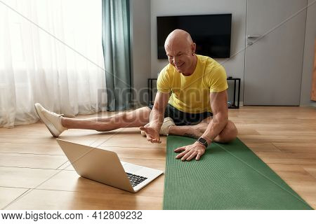 Online Training. Happy Mature Personal Fitness Having Virtual Fitness Class, Looking At Web Camera A