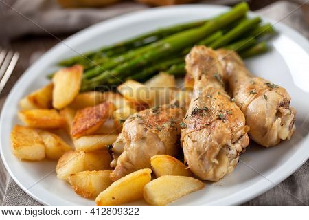 Roast Chicken With Potatoes And Asparagus. High Quality Photo.