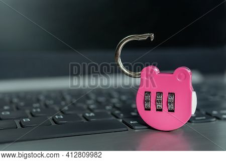 Pink Combination Lock On A Laptop. Selected Focus. Open