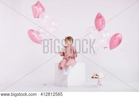 Happy Birthday 2 Years Old Little Girl In Pink Dress. White Cake With Candles And Roses. Birthday De