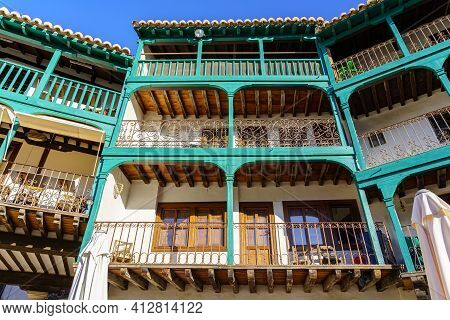 Typical Balconies In The Central Square Of Chinchon In Madrid, Old Wooden Balconies In All The House