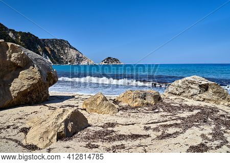 Boulders On The Sandy Beach At Petani Bay On The Island Of Kefalonia In Greece