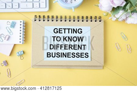 Text Getting To Know Different Businesses On White Paper Book On Table. Business Concept
