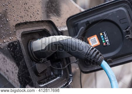 Electric Vehicle Is Being Charged - Electric Car Connected To Charging Station