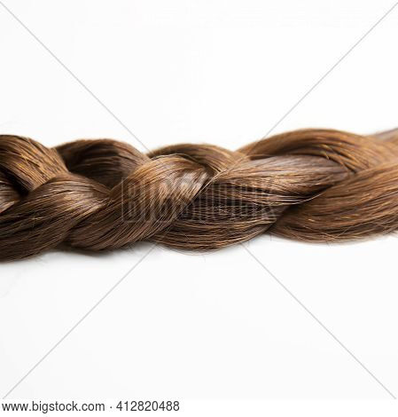 A Braid Of Dark Brown Hair On A White Background. Top View. Close-up. Hair Style. Brown Hair: Chestn