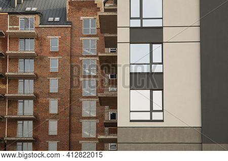 Modern Residential Apartment Building From Red Brick Finished And Unfinished Part