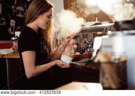 Female Barista Making Coffee In Coffee Shop Counter. Barista Female Working At Cafe