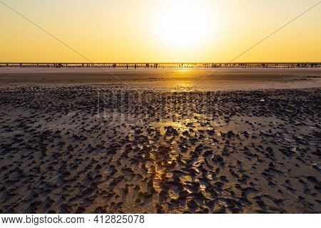 Golden  Sunset Over Syvash Lake. Salt Lake With Healing Mud In The Rays Of The Setting Sun. Beautifu