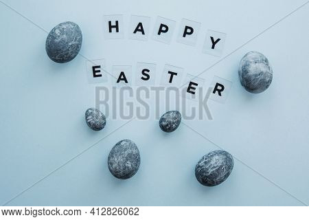 Modern Composition For Easter Holiday On Blue Background, Lettering Happy Easter 2021, Painted Blue