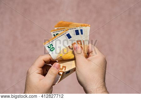 Hand Couting Holding And Showing Euro Money Or Giving Money. World Money Concept, 50 Euro Banknotes