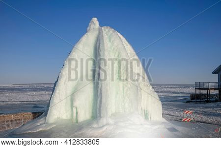 Tall structure created with ice sculpting by lake Huron in Michigan