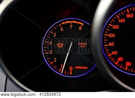 Car Dashboard With Stop Engine Sign. Car Malfunction, Engine Maintenance Is Required. Closeup Image