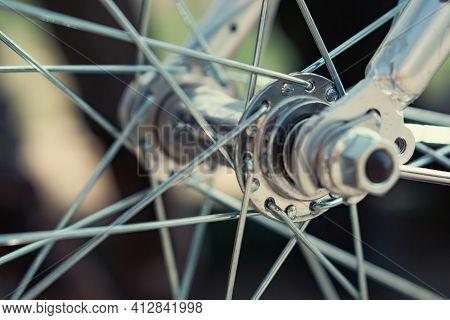 Shiny Chrome Bicycle Spokes. High Quality Macro Photo