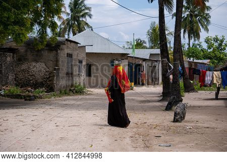 Nungwi, Tanzania - January 2020: Nungwi Village, Black African Woman On The Street Of Fisherman Vill