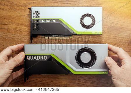 Senior Engineer Hands Pov Holding Looking Comparing Two New Gpu Nvidia Quadro Rtx 4000 Rtx 5000 Base