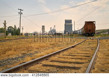 Oakesdale Rail Line And Grain Elevator. Railcars And A Grain Elevator In Oakesdale, Washington State