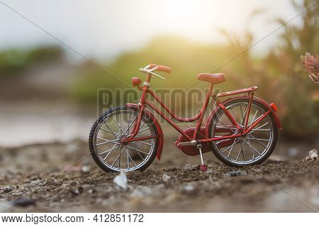 Red Bicycle Parking Outdoor In Nature Summer Holiday Sunset Background  Copy Spec
