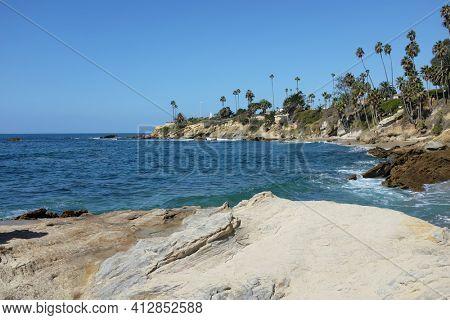 The Coastline at Laguna Beach, California, looking towards Recreation Point, with Heisler Park running along the bluff.